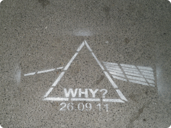 Photo by rjw1 of a chalk pyramid prism splitting light drawn on the ground