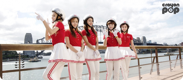 Crayon pop girl band on a single file with red outfit & helmet