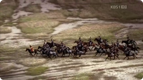Miniature size of Damdeok riding out with his army on a map