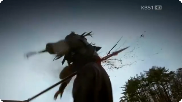 Asin's spear pierces Sagal Hyeon from the back and kills him