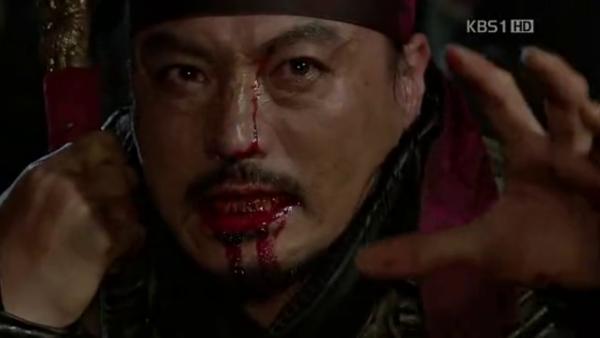 Commander Jin Mu on his knees right before he dies