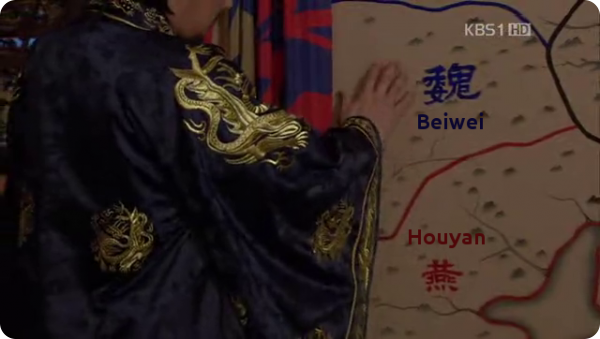 Damdeok's hand touching a map depcting Northern Wei and Later Yan