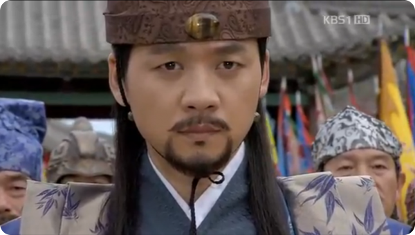 Houyan envoy Ko Un stares directly at Damdeok with a serious look