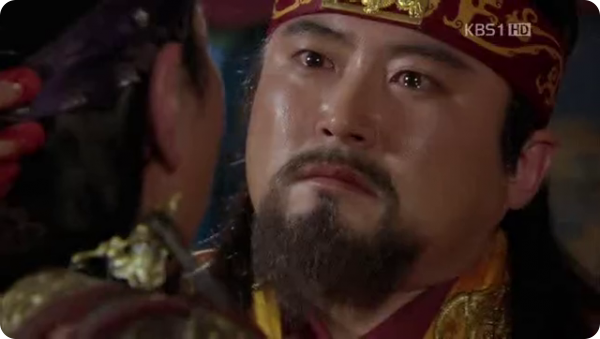 Murong Un's face expression as he dies in his brother's arms